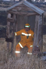 Aussie firefighter in a classic outback dunny